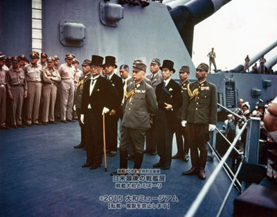 Japanese representatives on board USS Missouri (BB-63) during the surrender ceremonies, 2 September 1945. Standing in front are: Foreign Minister Mamoru Shigemitsu (wearing top hat) and General Yoshijiro Umezu, Chief of the Army General Staff. Behind them are three representatives each of the Foreign Ministry, the Army and the Navy. They include, in middle row, left to right: Major General Yatsuji Nagai, Army; Katsuo Okazaki, Foreign Ministry; Rear Admiral Tadatoshi Tomioka, Navy; Toshikazu Kase, Foreign Ministry, and Lieutenant General Suichi Miyakazi, Army. In the the back row, left to right (not all are visible): Rear Admiral Ichiro Yokoyama, Navy; Saburo Ota, Foreign Ministry; Captain Katsuo Shiba, Navy, and Colonel Kaziyi Sugita, Army. (Identities those in second and third rows are from an annotated photograph in Naval Historical Center files.)   Photograph from the Army Signal Corps Collection in the U.S. National Archives.